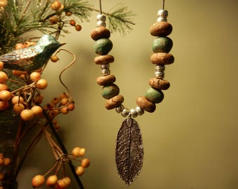 Earth bound Contemporary stoneware pottery necklace with leaf pendant ....very urban rustic