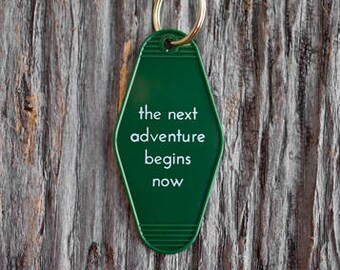 The Next Adventure Begins Now Motel Keytag