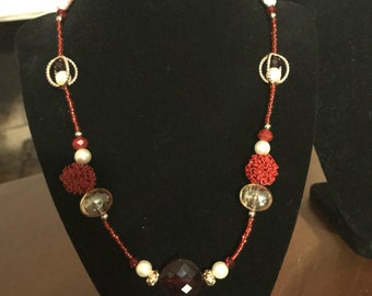 Red silver and pearl beaded necklace.