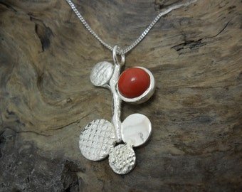 Ornate sterling silver to a red Jasper pendant
