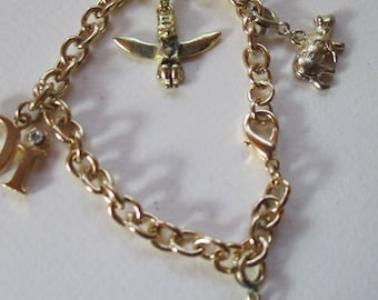 Vintage  Charm Bracelet on gold tone chain with lobster clasp closure 4 charms no markings
