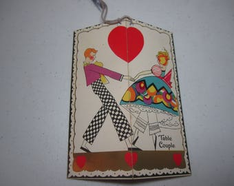 Colorful unused art deco gold gilded 1920's-30's Valentine themed bridge tally wrap around graphics of a young man and woman holding hands