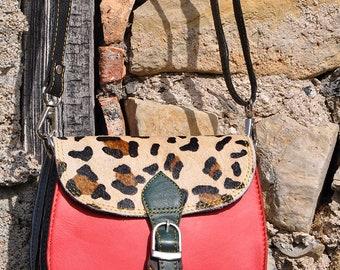 Small oval leather handbag
