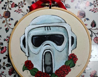 Original Painting of Star Wars Biker Scout Helmet with roses on beige painted on a 5 inch round embroidery hoop with red ribbon for hanging