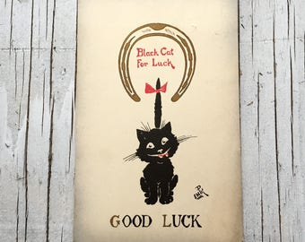 Black cat for luck postcard. Vintage 1930s postcard. Used postcard with Edward VII green 1/2 penny stamp on the reverse.