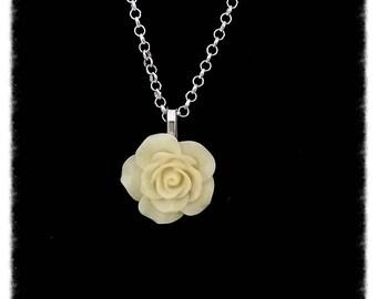 Creamy white with acrylic flower pendant