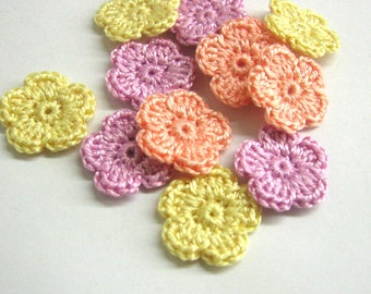 Crocheted tiny flower appliques 0.8 inches set of twelve yellow, peach pink and lavender