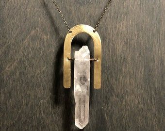 Large quartz point and brass necklace