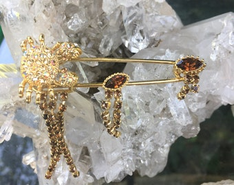 Pin sparkled with amber color stones Turtle with crystals