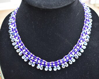 Beaded necklace with teardrop shaped drops and handmade extendable button toggle clasp