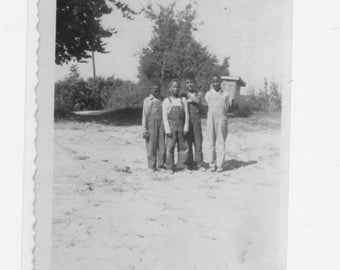 1930s  photograph of 4  African Americans boys on the playground at a one room school house a reprint from original photograph