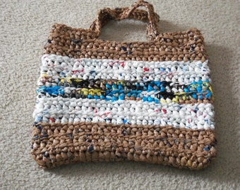 Tote made from recycled plastic bags (plarn). Brown with white and multicolor stripes.