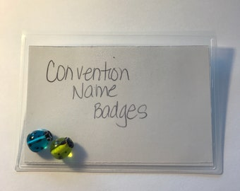 Convention name badge holders - embellished with a green and blue glass ladybugs.
