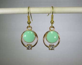 Gold finished greenish round shapes dangle earrings, clear rhinestone crystal