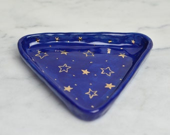 Royal blue ceramic triangle jewellery dish with hand painted gold lustre stars and polka dots pattern. Jewelry dish. Gift idea for her