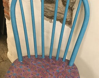 Upcycled chair with decoupage seat feature