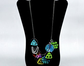 """The """"tink tink"""" one of a kind (un) fashion necklace."""