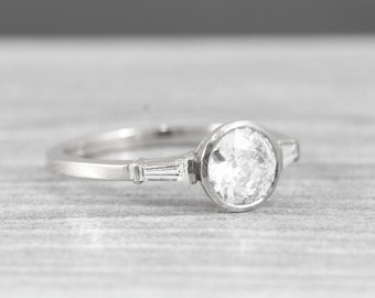 Moissanite and diamond engagement ring handmade in white gold with baguette accent stones