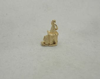 9 carat gold opening charm of a english village churh