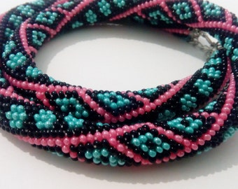 Beadwork necklace Bead crochet rope. Black with pink lines and blue dots and rombs