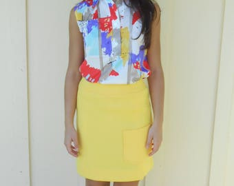Vintage 1960s HAYMAKERS mod bright yellow one-pocket polyester mini skirt, size 4 / 6
