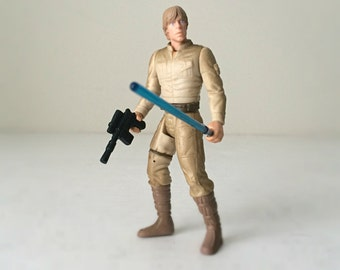 Luke Skywalker Star Wars Toy Action Figure, Star Wars Gift for Men, Empire Strikes Back Bespin Gear with Removable Hand & Lightsaber
