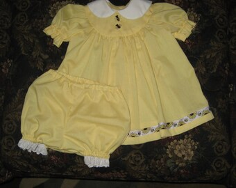 Baby girl dress size 6 to 9 months.