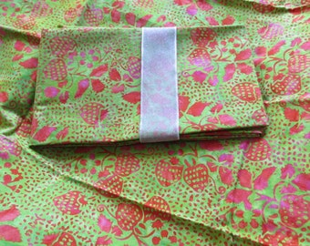 Batik fabric green with hot pink strawberries, high quality cotton.