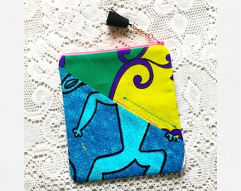 slow made zipper pouch - nite man: champion of the sun - from various Vintage Hawaii fabrics, machine stiching