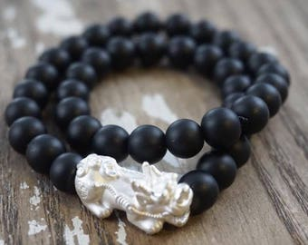 Natural obsidian gemstone bracelet with silver charm