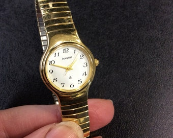 Accurist gold plated ladies bracelet watch
