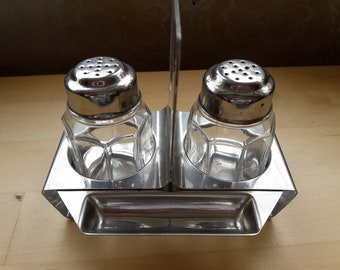 Salt and pepper tableware and toothpick holder in steel and glass