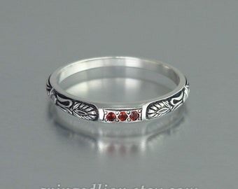 ALEXANDRA silver wedding band with garnets