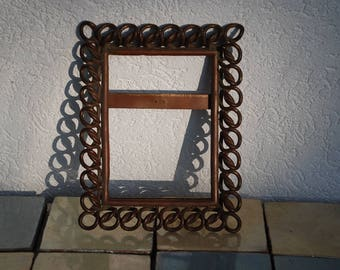 Picture frames made of necklaces-really heavy 70s vintage object without glass
