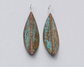 Bronze earrings with sterling silver hook. Earrings hand-forged, foldforming technique, size cm 6 x 1,5