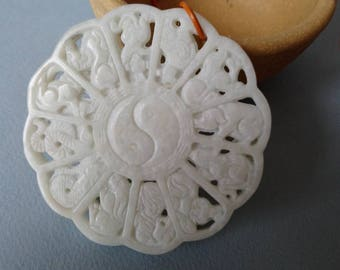 The Chinese Horoscope  :a wthite jade masterfully carved pendent