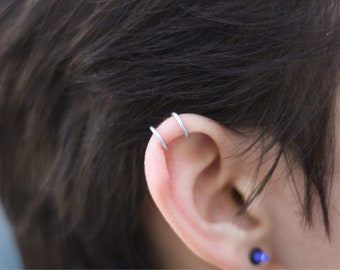 Set of Five silver ear cuffs! Non peirce and adjustable.