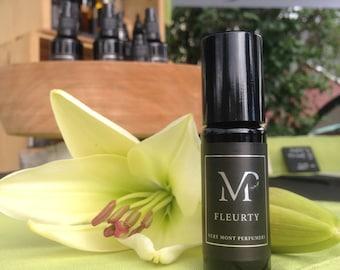 FLEURTY - Floral of Lily, Pink Lotus, and Honeysuckle, Botanical Musk, Amber, Oud, Violet & Bergamot.