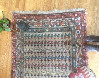 vintage, old wool rug, Persian rug, hand knotted, hand made, bohemian styled, well used, well loved boho rug, orange, retro style