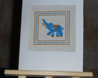Embroidered on canvas with a blue elephant in a frame card