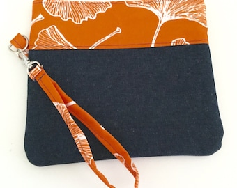 Orange, white and denim ginkgo wristlet with diamond print lining