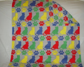 Kitty Blanket - bright colored cats and paws print fleece with matching bright colored paws print fleece on the reverse side.