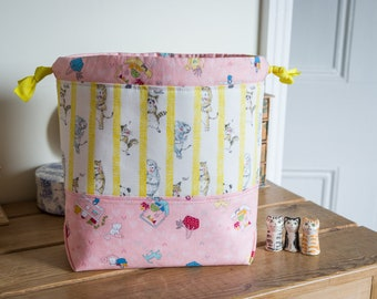 Drawstring project bag made with super cute Japanese cotton prints featuring animals and illustrations in yellow and pink