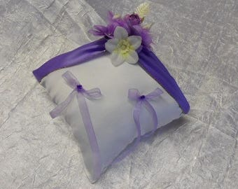 Purple and white wedding ring cushion