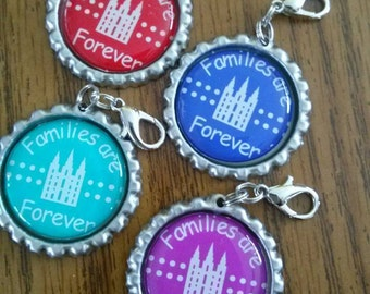 SOLD in LOTS of 5 - approx. 1.75 each.  LDS Primary Theme 2014 Families Are Forever Bottle Cap Zipper Pulls