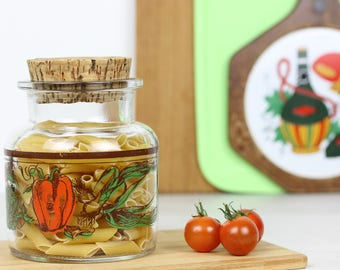 Glass storage with cork lid decorated with images of vegetables