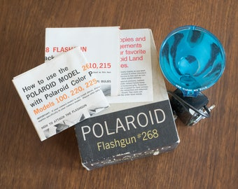 Vintage Polaroid Flashgun #268 - NM in box with paperwork.