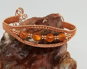"""Copper and shell beads make a beautiful 6.5"""" adjustable cuff bracelet."""