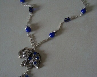 Elephant with blue rhinestone silver necklace