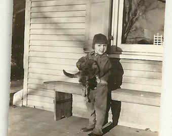 Vintage photo boy with cat kitten pet animal black and white shadow